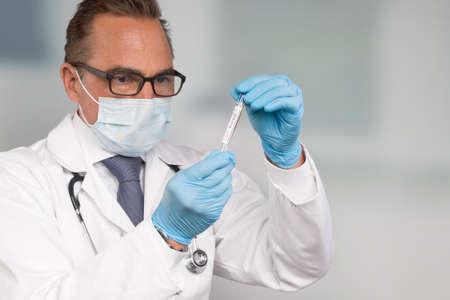 doctor or scientist handling a corona test tube in a laboratory room Zdjęcie Seryjne