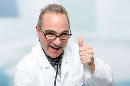 male doctor in front of a clinic room shows emotions