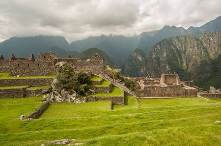 The ancient city of Machu Picchu, Peru. Overlooking ruins on the Inca citadel in the Andes Mountains and the river valley below Stock Photo