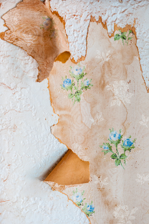 Vintage textures: old wallpaper, peeling paint, brick wall and layers of different colorful backgrounds.