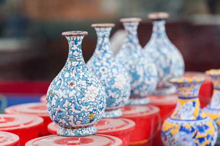 Workshop making enamel items such as bowls, vases and other home decor items in Beijing, China. Shots of porcelain enamel paint made from powdwred glass applied to metal surfaces. Stock fotó - 79107179