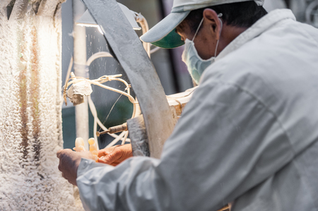 Chinese man working in the workshop making jade or stone items in Beijing, China. Stock Photo