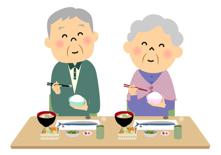 The elderly couple  eating a meal