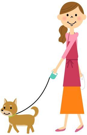 犬を散歩したエプロンの女性