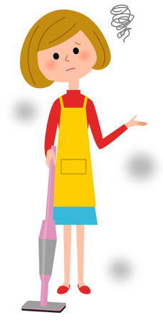 The female of the apron who vacuums cleaner