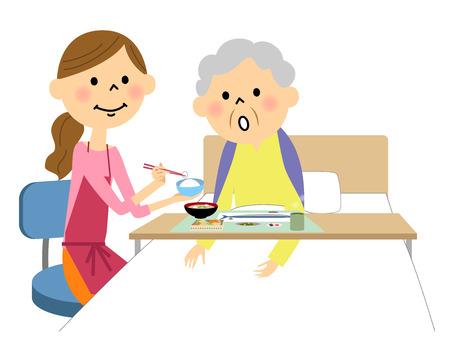 De bejaarde dame bijgestaan door een maaltijdverpleegster