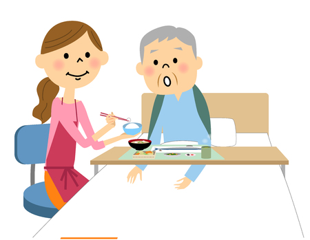 The elderly man assisted by a meal nurse