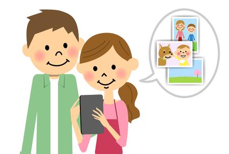 The couple who operates a tablet Ilustração