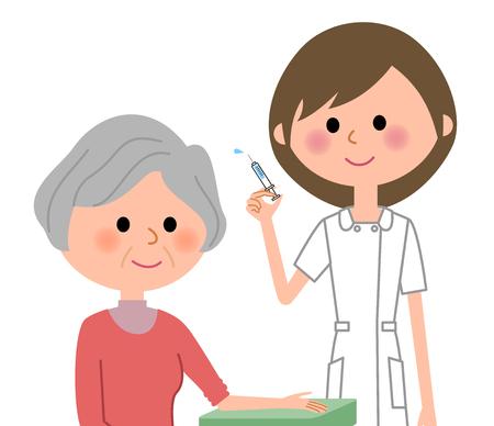 高齢者の女性に注射を与える看護師