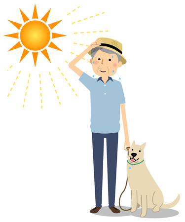 Elderly man wearing a hat walking a dog