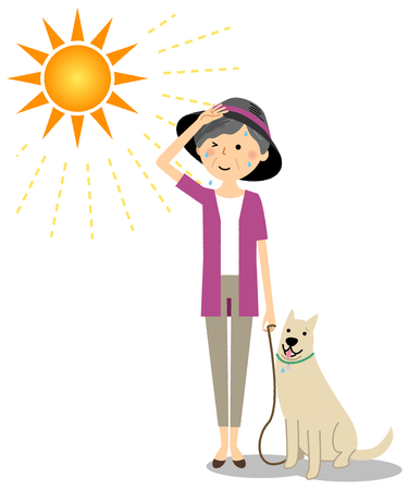 Elderly woman wearing a hat walking a dog