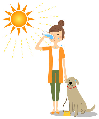 Young woman walking with dogs while hydrating Фото со стока - 117075250