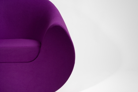 round chairs: A modern lounge chair upholstered in purple fabric