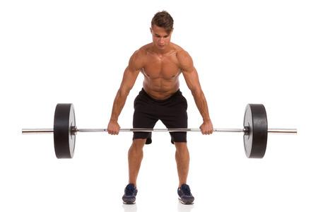 focus: Fit Man Doing A Deadlift Exercise. Full length studio shot isolated on white.