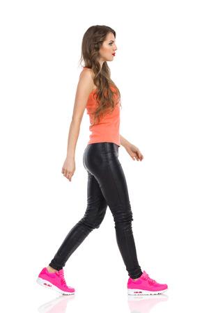 side shot: Casual Walking Woman. Side View, Full Length.