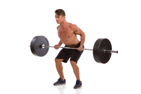 role models: Muscular man showing a barbell row exercise. Full length studio shot isolated on white.