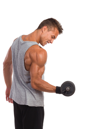 waist shot: Portrait of muscular man exercises with weight and flexing muscles. Side view. Waist up studio shot isolated on white.