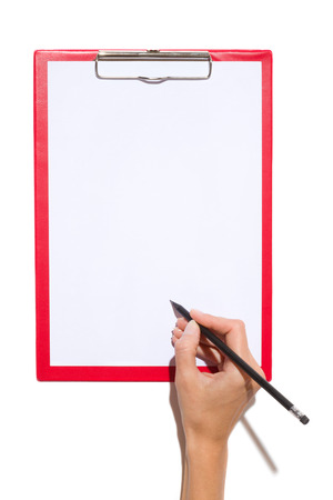 rubber sheet: Close up of womans hand holding black pencil with rubber and writing on a clipboard with empty paper sheet. Studio shot on white background with shadow. Stock Photo