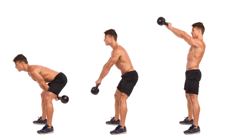 role models: Muscular man in sport shorts and sneakers showing a kettlebell exercise step by step. Full length studio shot isolated on white. Stock Photo