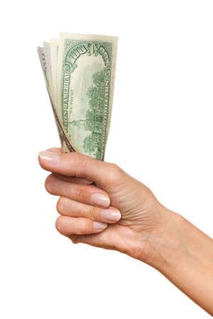 manos entrelazadas: Cerca de la mano de la mujer que sostiene un varios billetes de un d�lar. Tiro del estudio aislado en blanco.