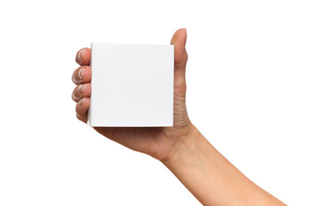 Close up of womans hand holding white carton box. Studio shot isolated on white.