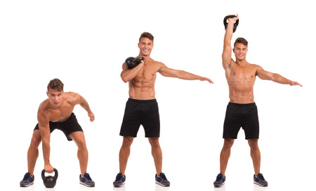 Fit man in sport shorts and sneakers showing a kettlebell exercise step by step. Full length studio shot isolated on white.