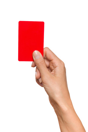 Womans hand holding plastic red card. Studio shot isolated on white.