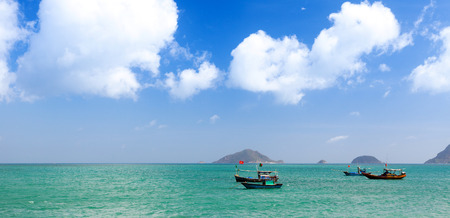 con dao: Vietnamese fishing boats on turquoise sea. View from the Con Dao beach.
