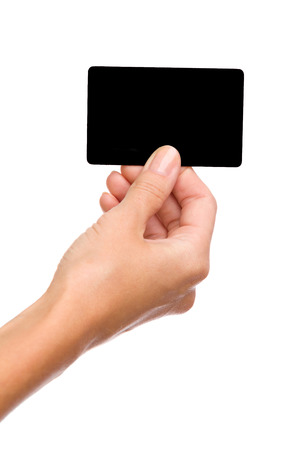 holding close: Close up of womans hand holding blank black card. Studio shot isolated on white. Stock Photo