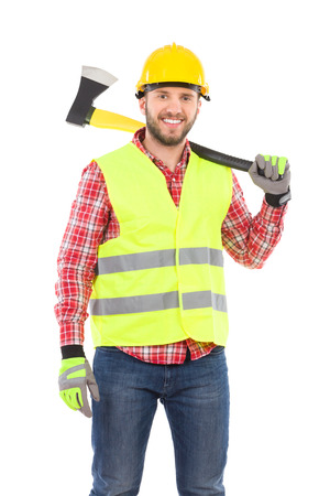 three quarter length: Happy man in lumberjack shirt, yellow helmet and lime reflective vest holding an axe on his shoulder. Three quarter length studio shot isolated on white.