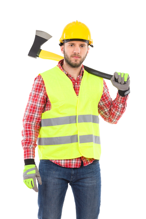 3 persons only: Serious man in lumberjack shirt, yellow helmet and lime reflective vest holding an axe on his shoulder. Three quarter length studio shot isolated on white.