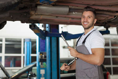 ratchet: Mechanic posing with a ratchet wrench Stock Photo