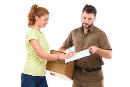 waist shot: Woman receives a package and signing a document. Waist up studio shot isolated on white.
