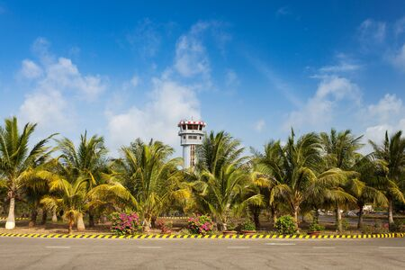 con dao: Con Dao Island, Con Son Airport. View at air traffic control tower among palm trees.