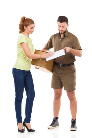receives: Woman receives a delivery and signing a document. Full length studio shot isolated on white.