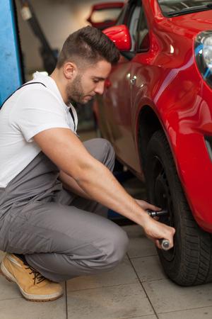 torque: Focused mechanic using a torque wrench