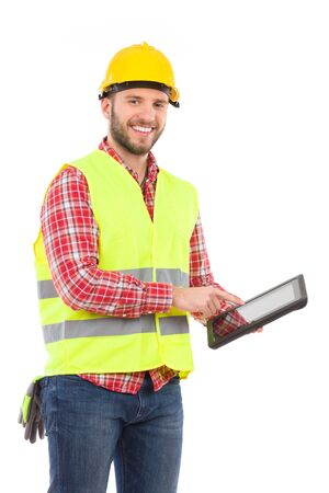 clothes organizer: Smiling manual worker in yellow helmet and lime waistcoat holding a digital tablet. Three quarter length studio shot isolated on white.