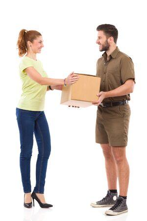 Messenger: Smiling female receives carton box from messenger. Full length studio shot isolated on white.