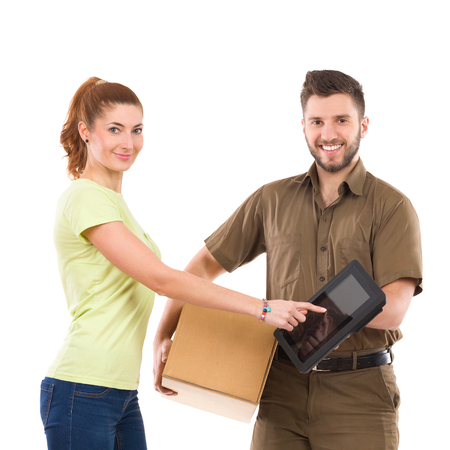waist shot: Woman receive a package and pointing at couriers digital tablet. Waist up studio shot isolated on white.