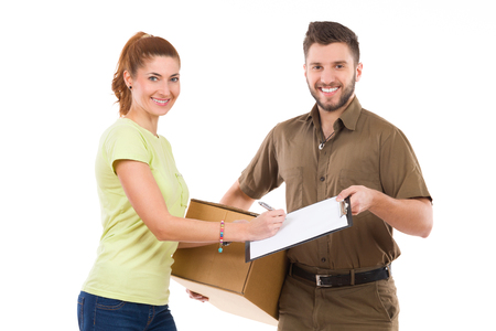 waist shot: Woman receive a package and sign a document. Waist up studio shot isolated on white. Stock Photo