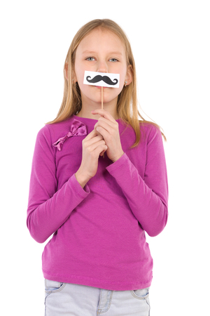 waist shot: Girl posing with a fake mustache. Waist up studio shot isolated on white.