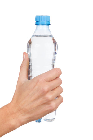 hand holding bottle: Close up of womans hand holding a plastic bottle with water. Studio shot isolated on white. Stock Photo