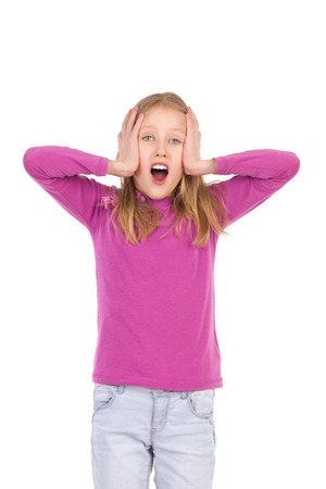three quarter length: Shouting young girl holding head in hands. Three quarter length studio shot isolated on white. Stock Photo