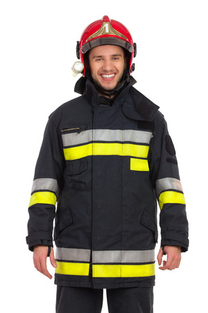 bombero de rojo: Smiling fireman posing and looking at camera. Waist up studio shot on isolated on white. Foto de archivo