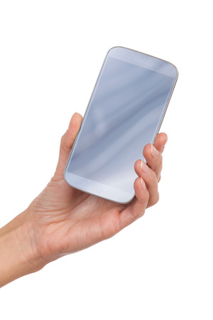 holding close: Close up of womans hand holding a smart phone. Studio shot isolated on white.