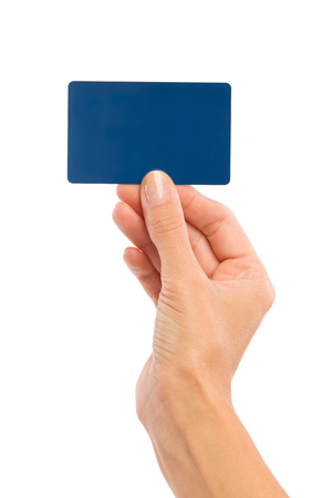 hand card: Close up of womans hand holding blank blue card. Studio shot isolated on white.