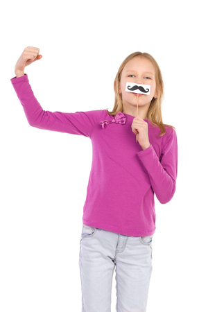 three quarter: Girl with a fake mustache rising arm with a fist. Three quarter length studio shot isolated on white.