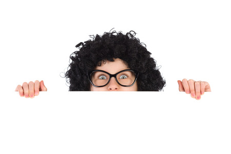 raised eyebrow: Nerdy girl peeking behind white placard and looking at camera. Studio portrait isolated on white. Stock Photo