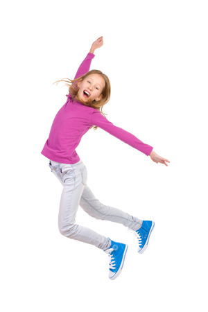 preadolescence: Jumping young girl with arm raised and mouth open. Full length studio shot isolated on white.