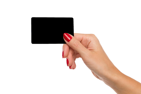 Close up of woman's hand with red nails holding blank black card. Close up isolated on white.